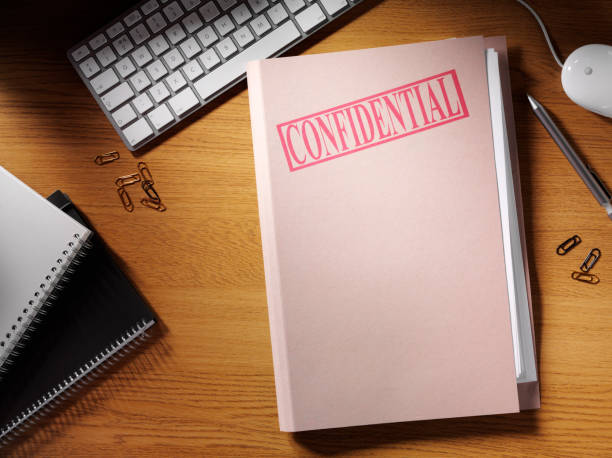 Desk With Folder Labeled as Confidential