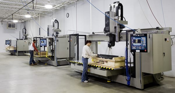 Thermoforming Professionals Working on Machines at the Joslyn Manufacturing Plant