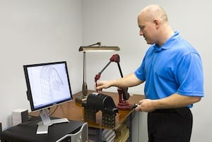 Joslyn Manufacturing Professional Performing Quality Assurance Check on a Thermoformed Product