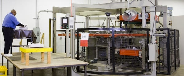 Thermoforming Professional Working on a Machine at the Joslyn Manufacturing Plant